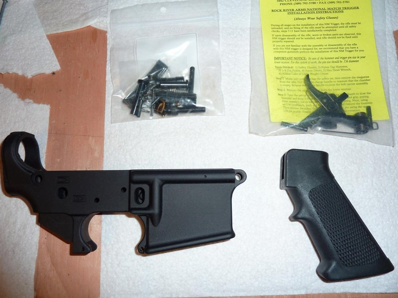 AR-15 Lower  and parts with 2-stage trigger || DMC-ZS3@4.1 | 1/30s | f3.3 | ISO100 || 2010-10-27 22:11:55
